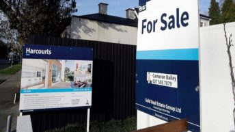 New Zealand bans most foreigners from buying homes