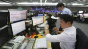 Asian shares gain on growing hopes for China trade talks
