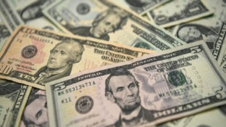 Dollar rally moves to Asia after US data but stocks suffer